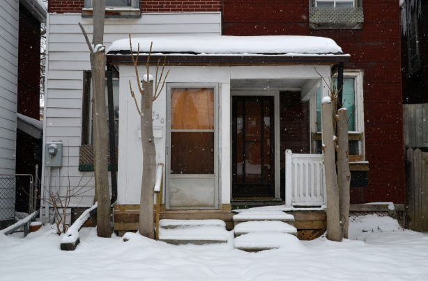 on gerrard st. east, snowy front yards