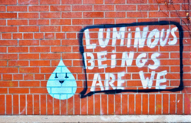graffiti that  says luminous beings are we