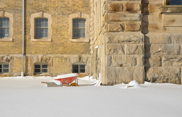 abandoned wheel barrow in front of the Don Jail