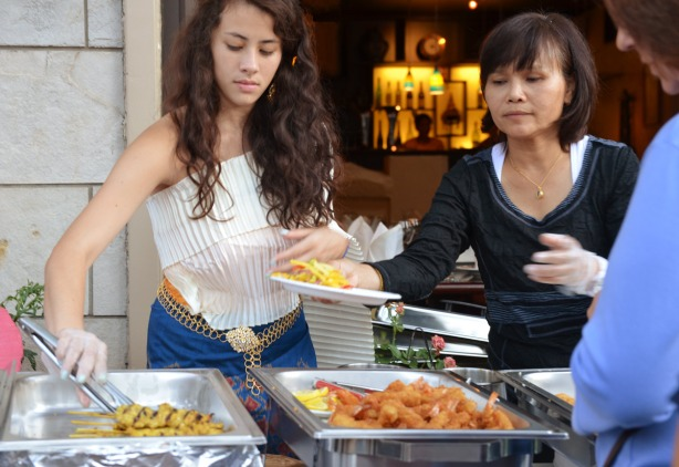 serving Thai food outside the Cha Da thai restaurant