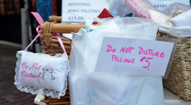 """little pillows for sale that have the words """"Do Not Disturb"""" embroidered on them"""