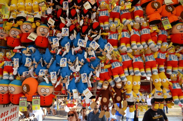 A wall of stuffed toys - Bart Simpsons and South Park characters