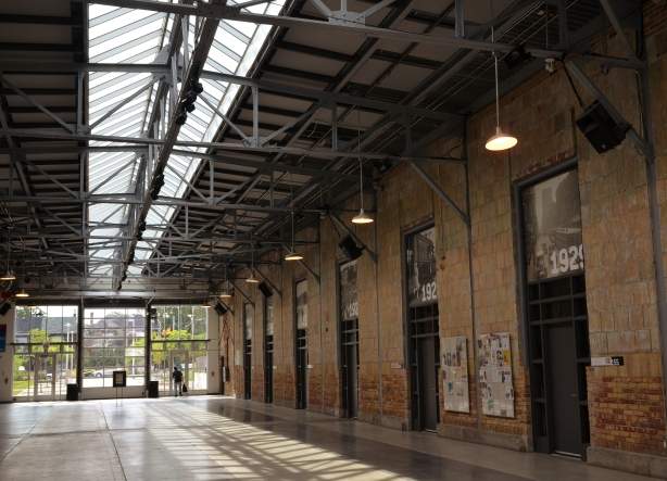 Interior of the present day Wychwood Barns, central part. Historical photos of Toronto streetcars hang over the doors on the right.