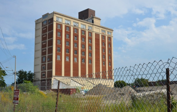 The ten storey Tower Automotive bulding.  In the foreground is the land left vacant after the demolition of the sheet casting machining buildings in 2010.