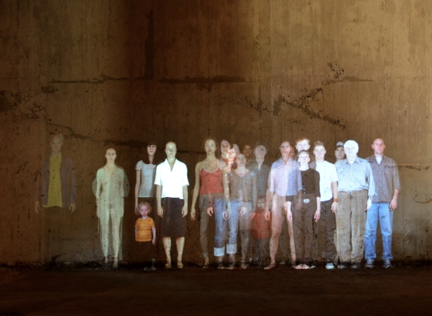 projection of life sized picture of a group of people