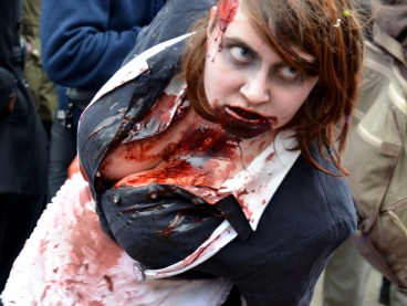 a woman with lots of fake blood on her chin and down her front
