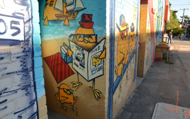 Part of the mural. Chickens are reading newspapers.