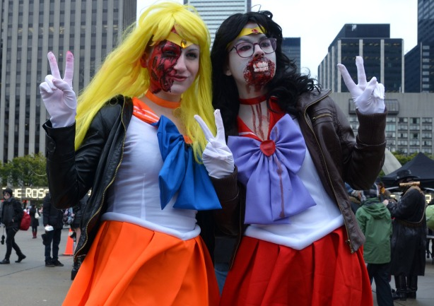 two girls with big bows around their necks, fake teeth and lots of blood