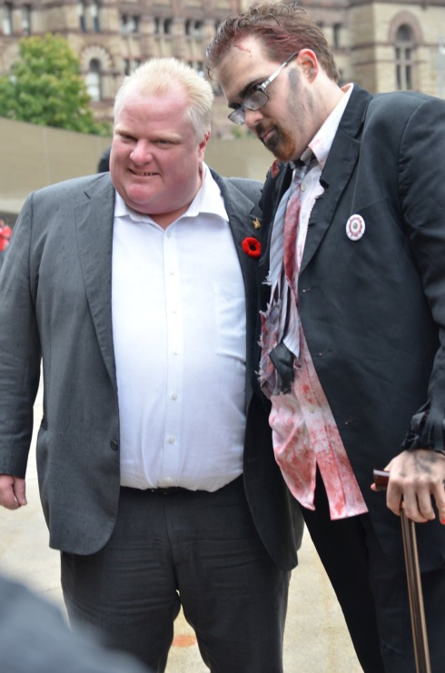Mayor Rob Ford poses for a photo op with a zombie