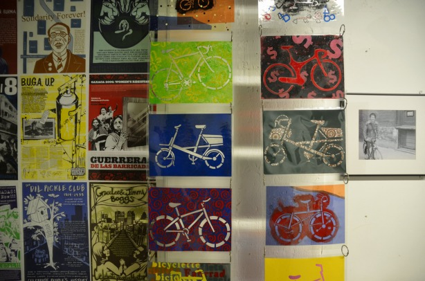 An art installation featuring pictures of bicylces.  Multicoloured.