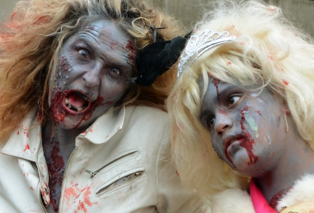 a mother and daughter dressed up as zombies.  Frizzy hair, grey skin and lots of fake blood dripping from their mouths.