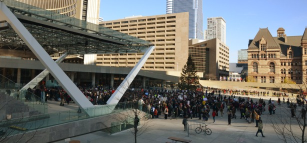 Nathan Phillips Square from the upper walkway, looking down at the crowd that has gathered for the protest