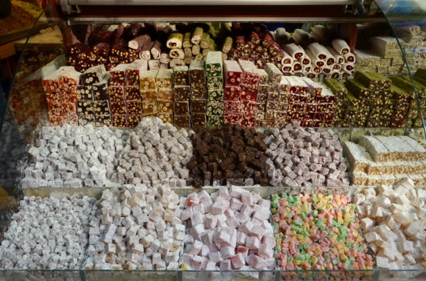 A store display of many types of turkish delight and other sweets.