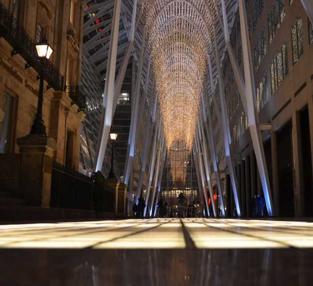 The long passageway through Brookfield Place with it's very high ceiling and lit glass panels on the floor.