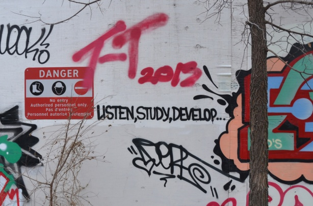 Graffiti of the words listen, study, develop
