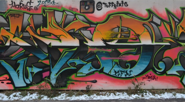graffiti tag in blues and oranges