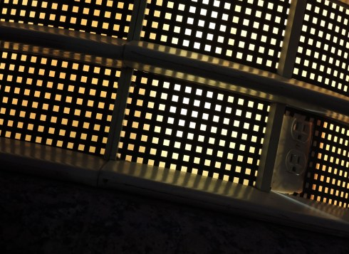 abstract picture made by a photo of a metal grid that is lit from behind.