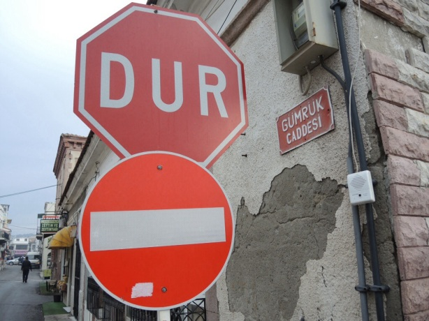 A stop sign, a no entry roadsign and a street sign in Turkey.