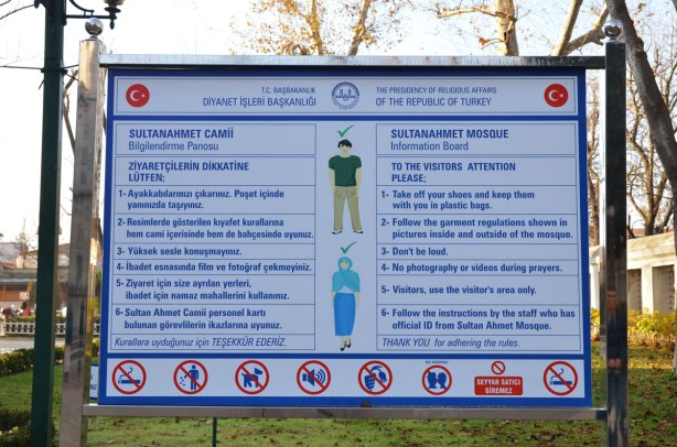 A sign in both Turkish and English with the rules for entering the mosque. Pictures show what clothing is appropriate.