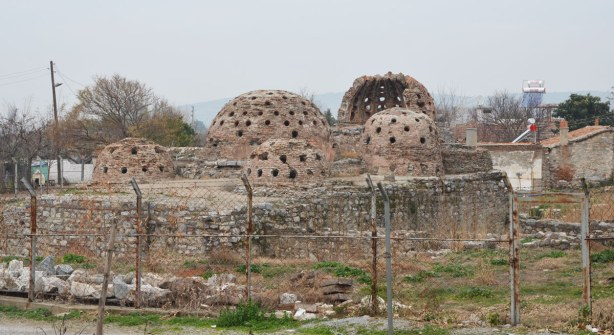 Ruins of an old stone and brick structure.  The roof had 4 domes, all with small windows in them.