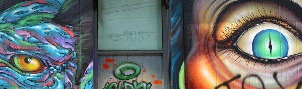 The number 508 is above the doorway.  An eye, part of two different murals, is on either side of the door.