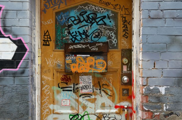 Doorway covered with stickers and scribbles