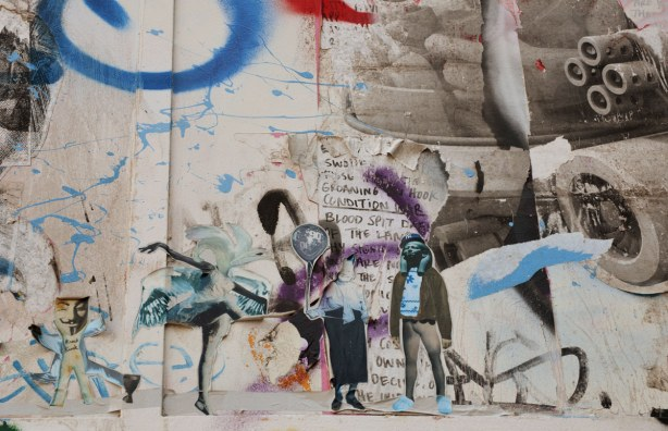 little people stuck to the wall, sticker street art on Kensington