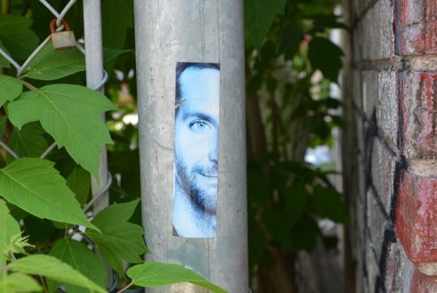 sticker of half of a man's face (cut vertically)