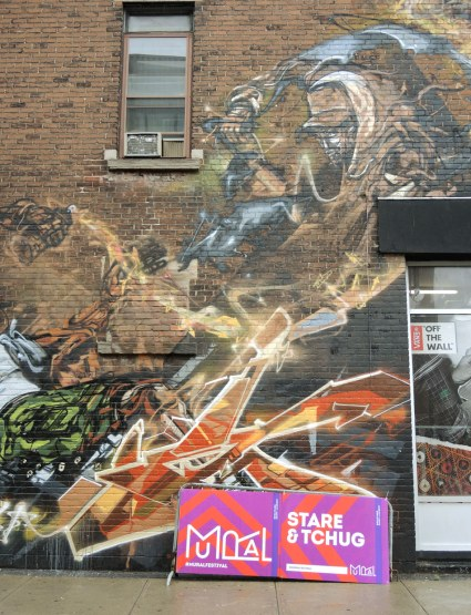 A mural on the side of a Montreal wall by Stare