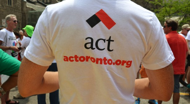 The back of a man's Tshirt with the logo for act along with their website