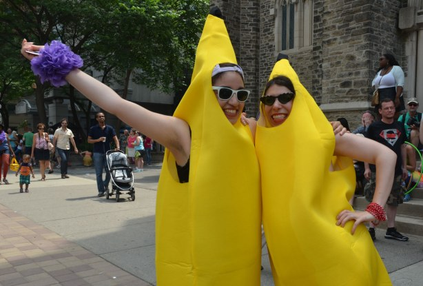 Two women in banana costumes posing for the camera.
