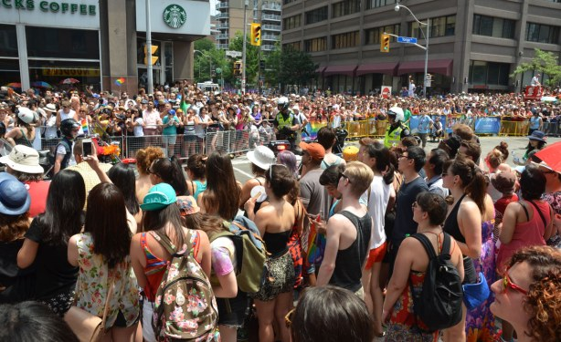 many people lining the route of the pride parade on Yonge St.