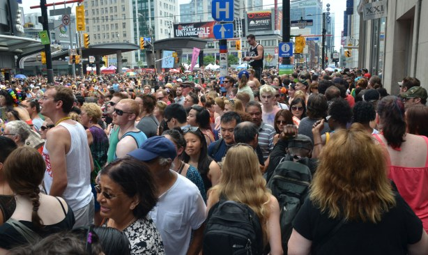 Wall to wall people at the intersection of Yonge and Dundas.  All you can see in the photo are people's heads.