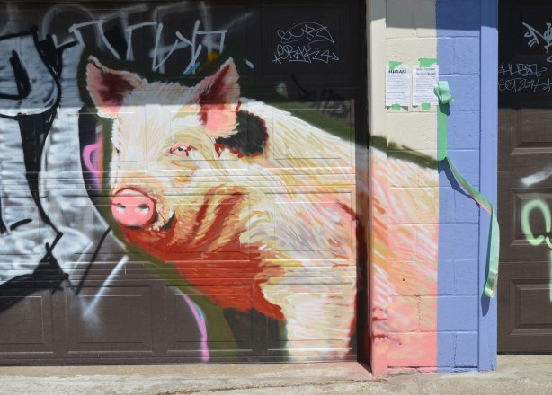 large realistic painting of a pink pig