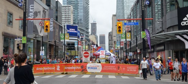 Yonge St. at Dundas, barrier across Yonge St. as it is pedestrians only.  Lots of signs, lots of people,