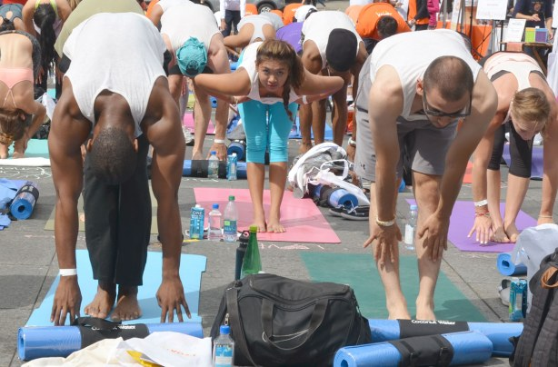 Group of people at 2014 yogathon, Dundas Square