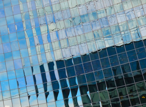 reflections in the window of the OPG (Ontario Power Generation) building, a curved glass structure.
