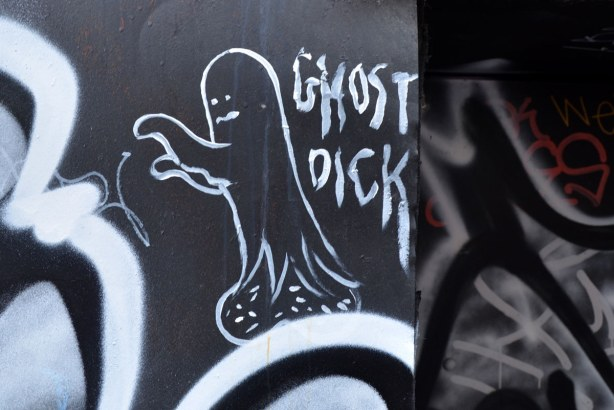 Ghost Dick are the words in the graffiti and they are accompanied by a white drawing of a ghost walking to the left with it's arms in front