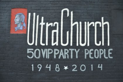 "sign painted beside the mural that says ""Ultra Church 50 VIP part people 1948 to 2014"""