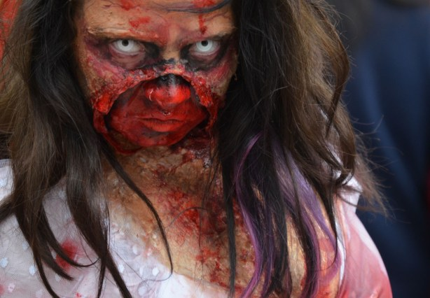 zombie from Toronto zombie walk - a woman with very bloody face, vacant stare, and long dark hair