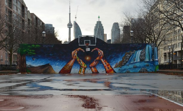 mural on the back wall of a basketball court