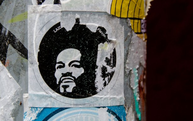 sticker of a man's head with an afro hairdo.