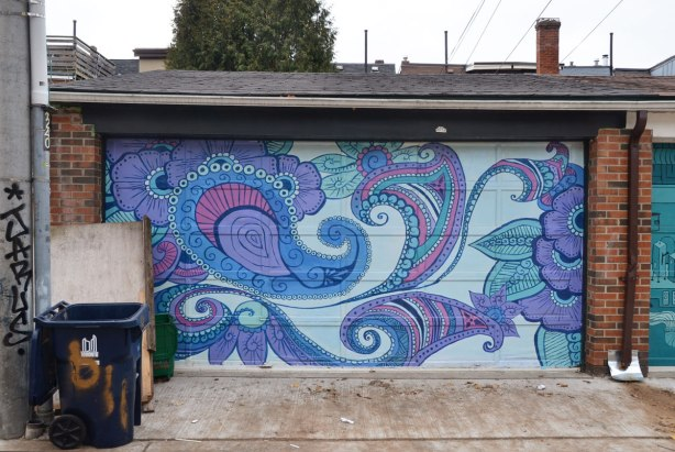 street art on a garage door - paisley shapes in blues and purples