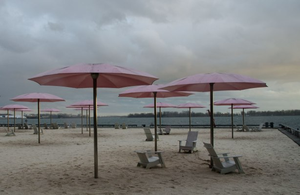 Sugar beach with its white chairs and pink umbrellas, there are no people here, and the lake is looking a little grey.