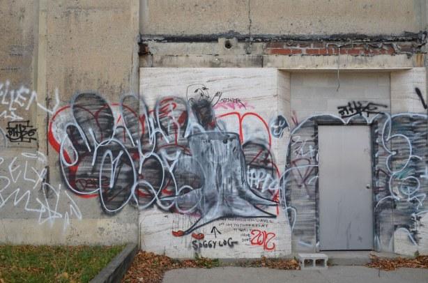 a tag over old graffiti