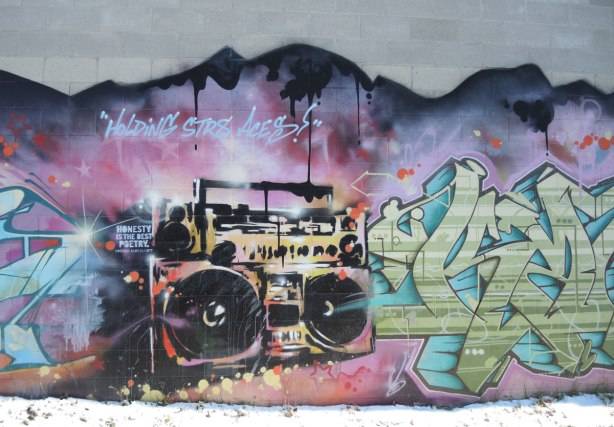 graffiti on a wall - painting of a 'boom box'' or ghetto blaster'