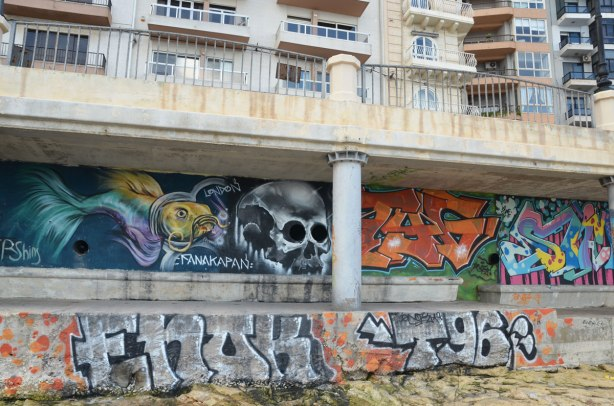 graffiti on a wall - skull and tags.