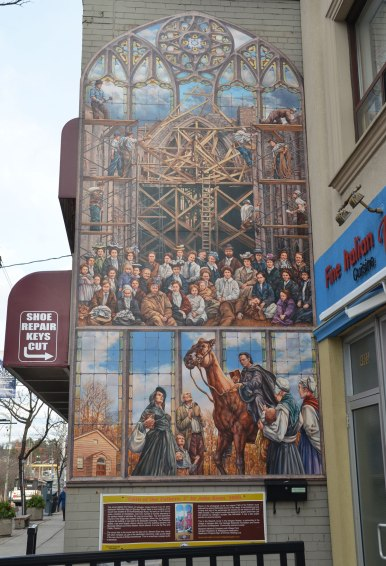 mural showing the building of a chirch