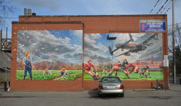 mural showing men playing football in the 1920s, with a low flying airplane overhead.