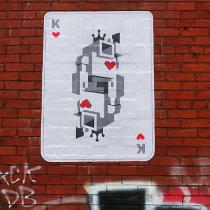 Lovebot now looks like he's been made into the king of hearts on a playingcard.  On a brick wall.